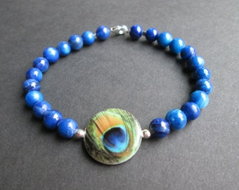 Peacock feather design and blue shell bead bracelet
