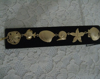 AWESOME SEALIFE BRACELET - Beautiful Goldtone Color and Finish - Fold Over Clasp