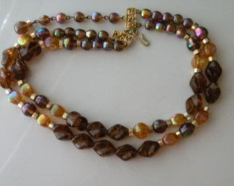 On Sale Hobe beaded necklace. Brown beads, yellow brown irridescent beads