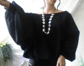 Elegant ladies tunic with bat sleeves