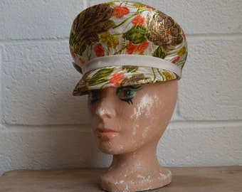 Womens Hat 1960s Oversize Newsboy Cap Hat in a Off White Orange and Brown Floral Gold Metallic with Ribbon and Bow Band Very Groovy Hat