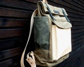 Waxed canvas backpack with fold to close top and vegetable tanned leather shoulderstrap and back reinforcement