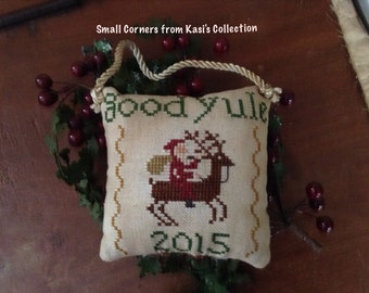 "7th in series ""2015"" Cross-stitched pillow ornament"