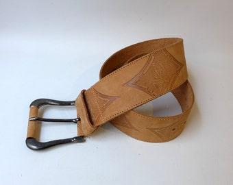 Vintage boho embossed pale tan designer Benetton Tuareg wide belt