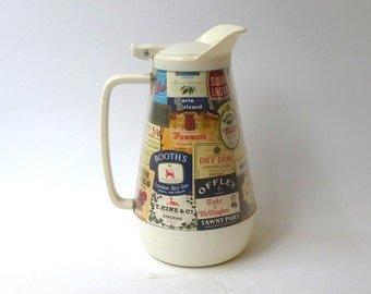 Vintage 1960s retro insulated bar pitcher with drink liquor label decoration, hot and cold jug