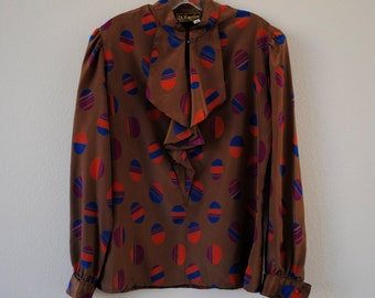 a vintage 60s 70s multicolored button down with ruffle top blouse. sz 13/14.