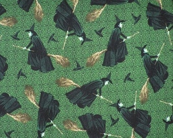 Wizard of Oz Wicked Witch on Broom Tossed on Green Fabric by Quilting Treasures OOP HTF- sold by the yard