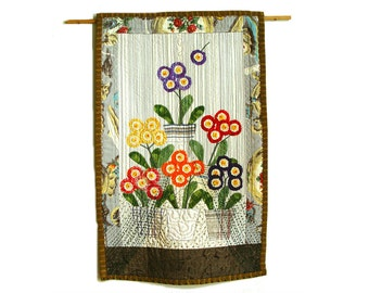 Auriculas theatre textile art - bright colorful floral wall hanging