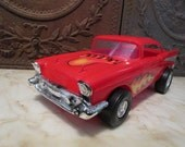 Vintage plastic, red, '57 Chevy with flames made by 'Processed Plastics, USA!