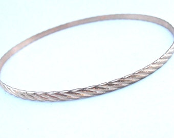 Vintage Gold Tone Spiral Bangle Rose Pink Hue Stackable Thin Bracelet Skinny Diagonal Line Texture Slim 8.25 Inches Jewelry Villacollezione