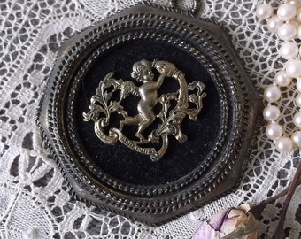 Vintage wall plaque, Petite Octagon, Metal cherub, Aquarius, antiqued goldtone and black