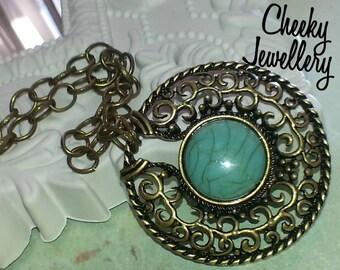 Ladies medium length necklace with turquoise medellion pendant