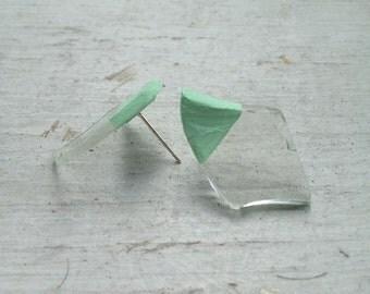 broken glass in seafoam earrings.
