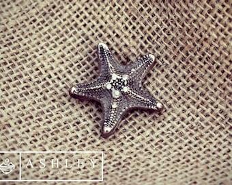 Starfish pendant with cubic zirconia handmade from bronze