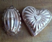 Two copper moulds, molds, from Korea, ODI, one heart shaped, one oval