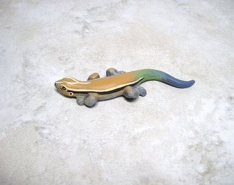 Ceramic miniature lizard