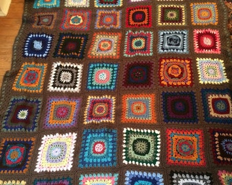 Wild Card Afghan in Fun Colors with a Brown Green Border