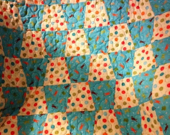 "Frogs, Dots and Circles Jump and Swirl Together In This 38"" X 40"" Tumbler Quilt For Baby"