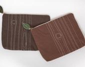 5 custom woodgrain pouches with straps