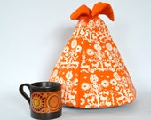 Orange fabric retro tea cosy
