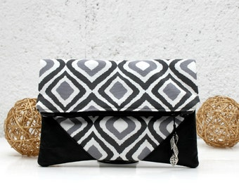 Clutch, handbag,  fold over clutch, cotton canvas and fake black leather, geometric print in grey tones.