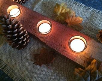 Reclaimed barnwood tablescape burlap tea lights candles pine cones