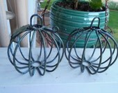 Two small round  wrought iron wire bird cages.  Pumpkin design and shaped. SAVE on shipping cost