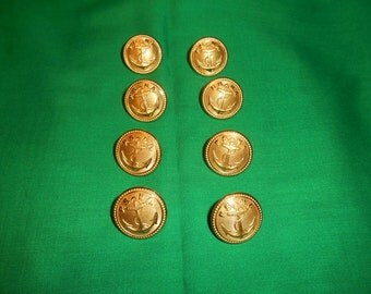 Eight (8) Brass Buttons, from the Waterbury Button Co., in the Puget Sound Naval Academy Pattern.