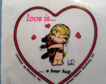 LOVE IS....a bear hug-vintage sticker, 1970