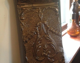 Distressed stained light brown/tan with metal ornate antique tin ceiling/wall tile