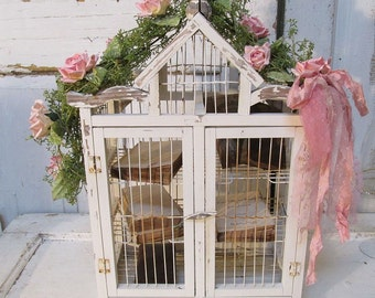 Ornate birdcage with shelves painted white shabby cottage chic pink roses embellished wood and wire bird cage home decor anita spero design