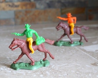 Nine cowboys - collectible 1960s swivel hip plastic toy cowboys - Lido Western Playset - mounted cowboys and posed cowboys