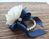 Wrist Corsage, White rose with navy ribbon on pearl bracelet