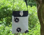 Cross body sling in Navy and mint