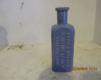 1890's  Prof I. Hubert's Malvina Lotion Toldeo, Ohio 5 Inch Tall WT CO Purple Lavender Milk glass medicine bottle
