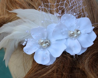 Beautiful white  color hair comb with pearls and white feather