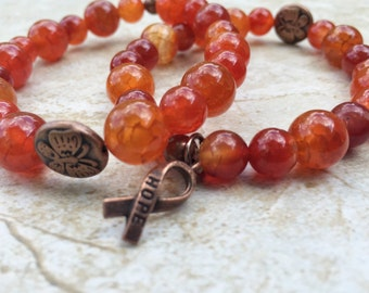 Leukemia Awareness Bracelet, orange beads with bronze HOPE ribbon, cancer awareness