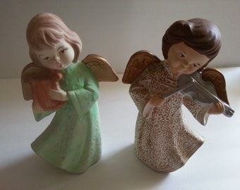 Two Ceramic Angels Playing Musical Instruments