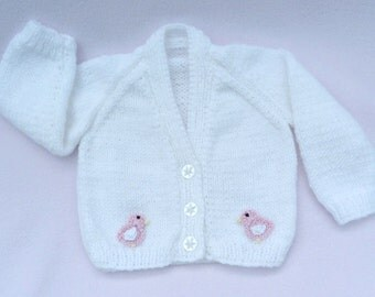 Baby sweater.  Hand knitted white cardigan to fit  0-3 months