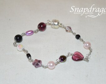 Purple beaded bracelet with magnetic clasp