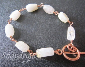 Rutile quartz beaded bracelet with copper toggle clasp
