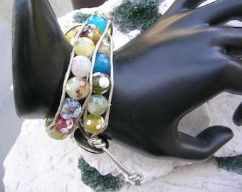 Multi color gemstone double wrap bracelet.