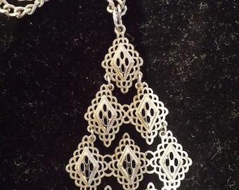 Funky 60's diamond shaped silvertone pendant