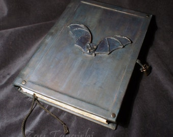 Book of Shadows with a Blue Bat