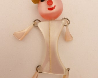 Vintage Moonglow Lucite and Bakelite Figural Crib Toy Style Brooch