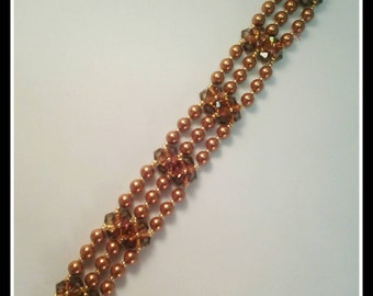 Elegant combination of copper Swarovksi crystals and pearls.