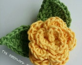 Medium sized yellow crocheted flower brooch with 2 leaves