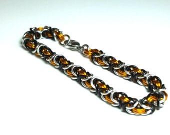 Orange, Black, and Silver Anodized Aluminum Byzantine Chainmaille Bracelet