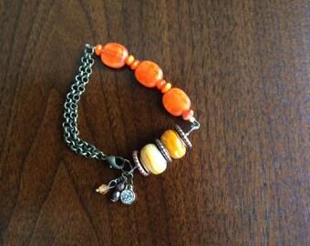 Orange and copper blacelet