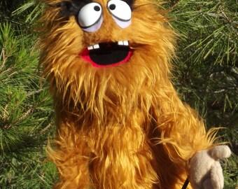 sr.Indented the monster,Enjoyable brown monster puppet wooden rods